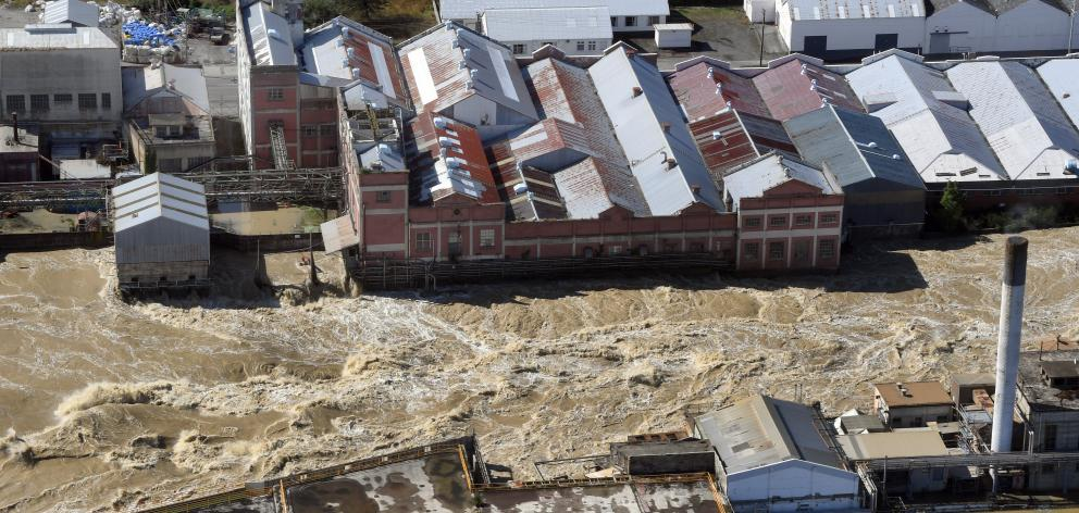 The flooded Mataura River gushes past the former paper mill earlier this week. PHOTO: STEPHEN...