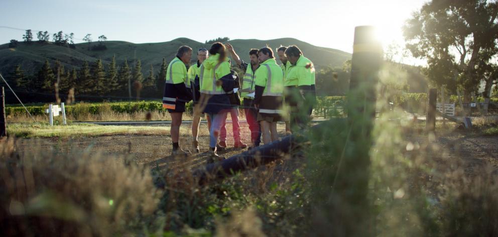 Marlborough viticulturist Stu Dudley talks to the vineyard team before they start work early.