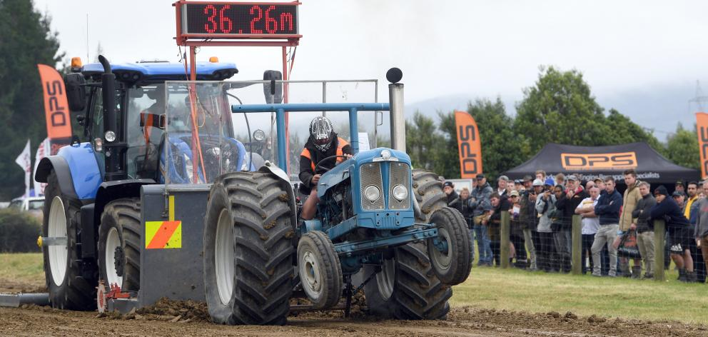 Mark Dillon, from Riversdale, attracts a crowd as he competes in the tractor pull at the Southern...