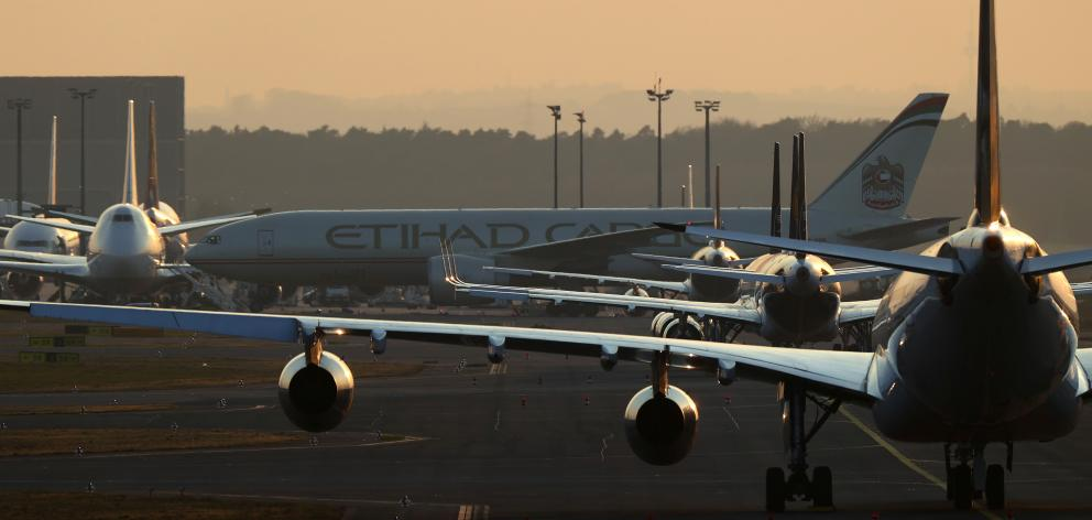 Airplanes are parked on the tarmac as air traffic is affected by the spread of the coronavirus...