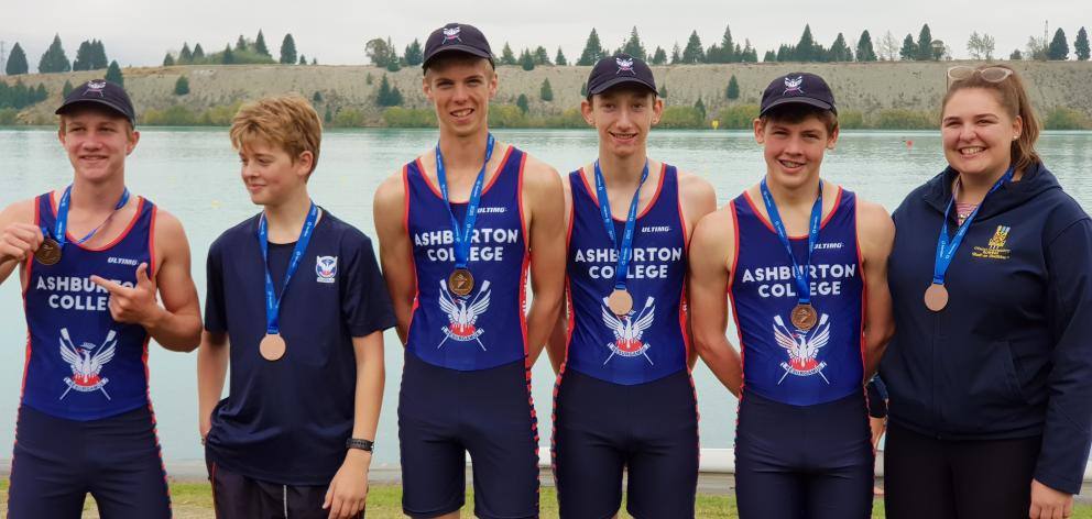 On the podium, and all smiles are Ashburton College rowers bronze medal winners Matthew Pearce,...