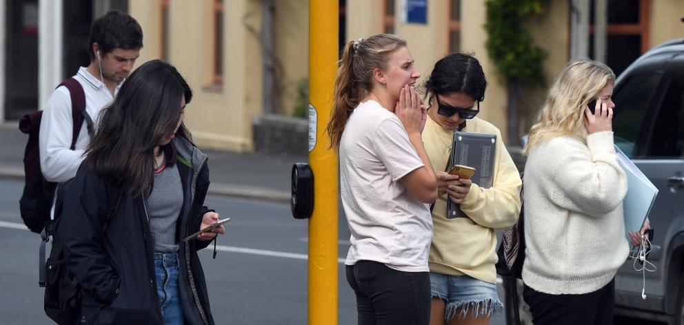 Young people near the University of Otago react to the news New Zealand's Covid-19 status was...