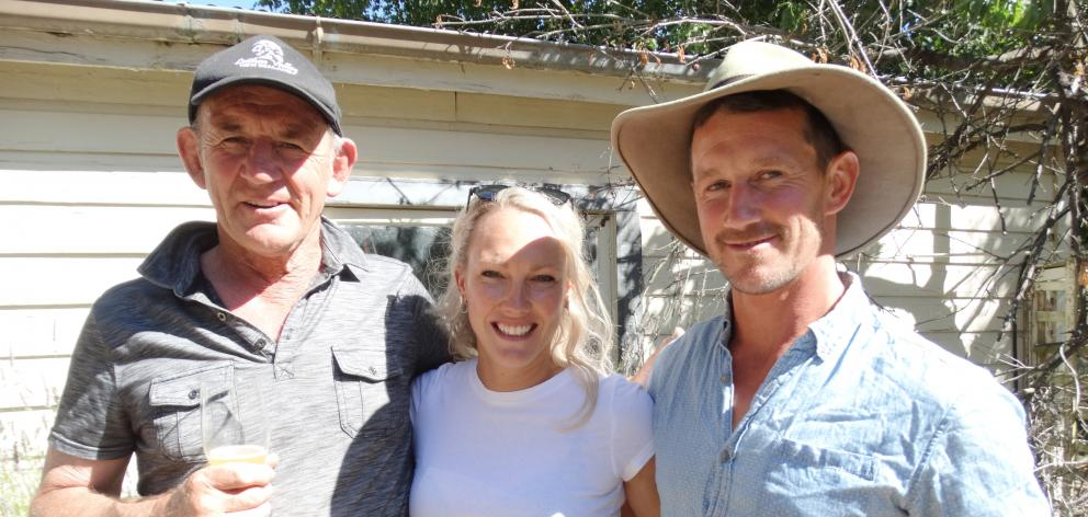 Former All Black Ken Stewart with son Hamish and new daughter-in-law Courtney Stewart, nee Smith,...