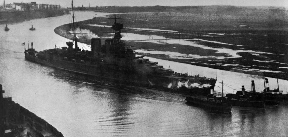 The £6 million cruiser HMS Hood leaving the Clyde for her trial trip. She is 260 metres long, displaces 41,000 tons, and has a designed speed of 31 knots. [She was sunk during the battle of Denmark Strait by ships of the German Kriegsmarine on May 24, 194
