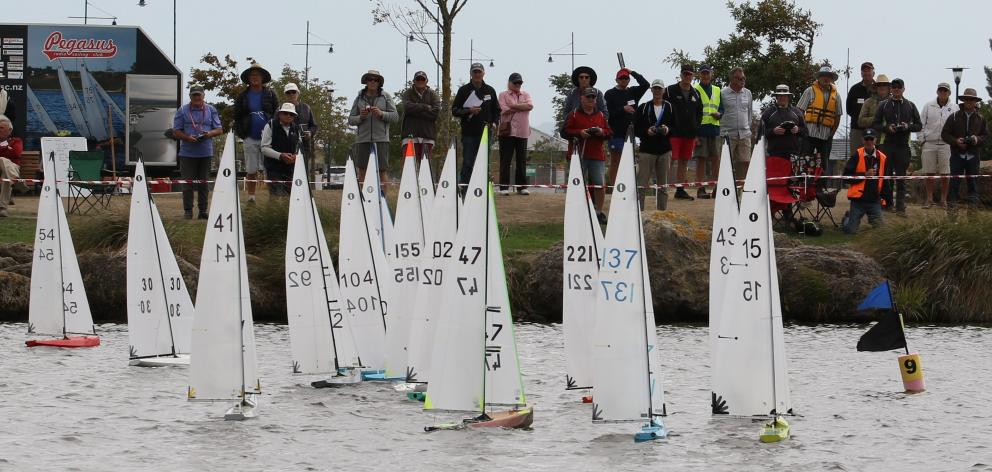 Radio-controlled yachts race in the South Island One Metre Regatta.