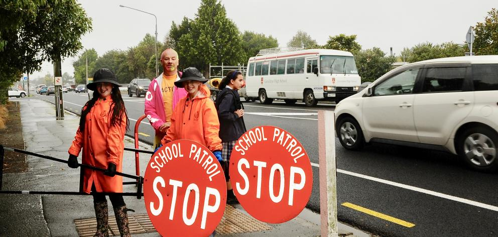 Mackenzie Cole, left, aged 12, of Woodend, with Ashley Kerr, aged 11, of Woodend, and Woodend School teacher Darryl Shekleton, of Rangiora, at the end of their afternoon road crossing patrol last Friday. Photos: Shelley Topp