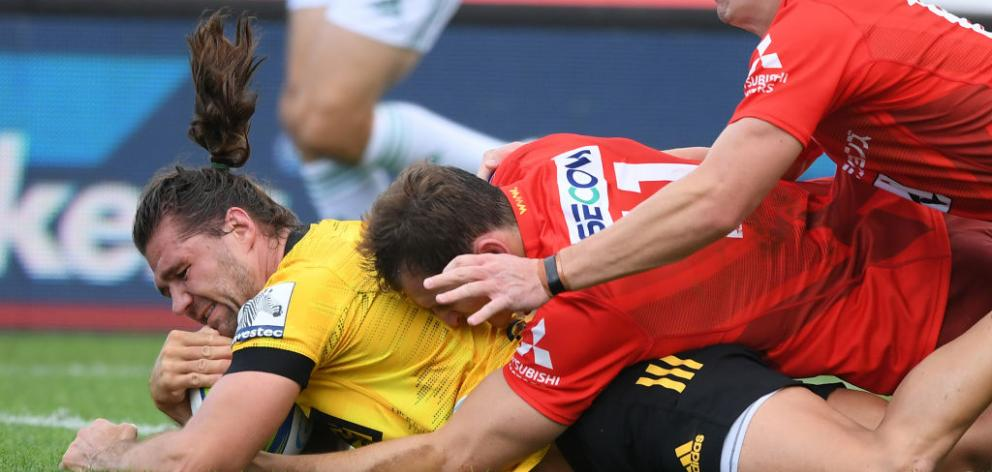 Kobus Van Wyk of the Hurricanes scores a try during the round five Super Rugby match between the Hurricanes and the Sunwolves. Photo: Getty Images