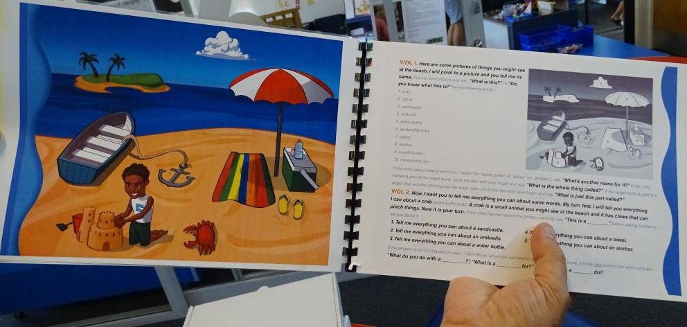 The storybook A Day at the Beach has prompts for teachers to have a 