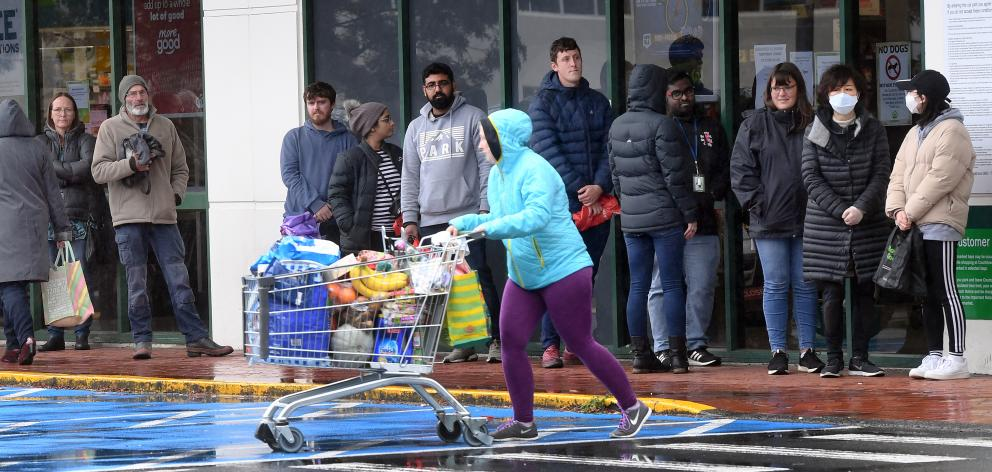 Countdown Central Dunedin supermarket became so congested yesterday that security staff controlled entry to the store. Photo: Stephen Jaquiery