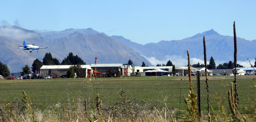 A light aircraft lands at Wanaka airport. PHOTO: STEPHEN JAQUIERY
