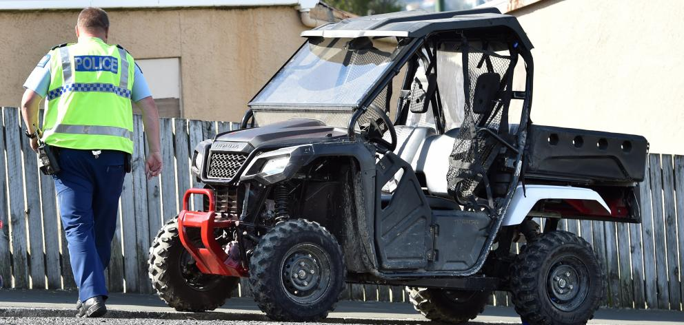 Police inspect the ATV yesterday. Photo: Peter McIntosh