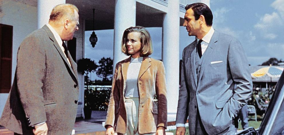 """Actors Gert Frobe (from left), Honor Blackman and Sean Connery on the set of """"Goldfinger"""". Photo: Photo by Sunset Boulevard/Corbis via Getty Images"""