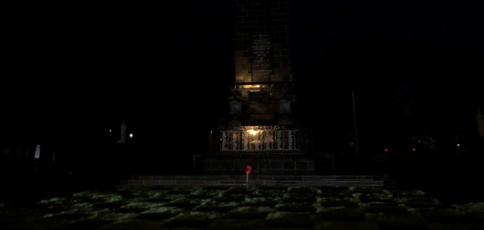 A lone poppy at the base of the Invercargill Cenotaph for Anzac Day. PHOTO: LAURA SMITH