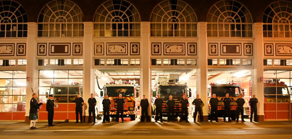NZ Fire and Emergency crew members gathered outside Dunedin's Central Station to pay tribute this...