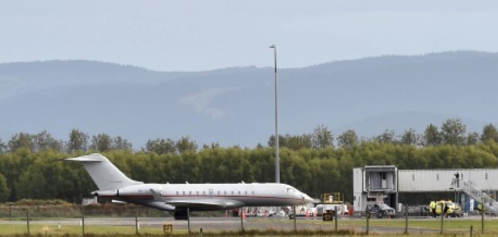 Mystery flight ... A Bombardier Global Express jet sits on the runway at an otherwise all but...