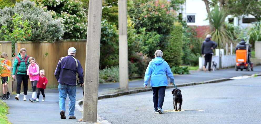 Walkers socially distance themselves in Woodhaugh yesterday. PHOTO: CHRISTINE O'CONNOR