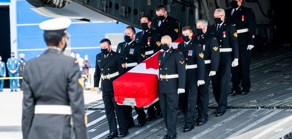 Repatriation ceremony for the Canadian Forces personnel killed in a military helicopter crash in the Mediterranean, at CFB in Trenton. Photo: Reuters