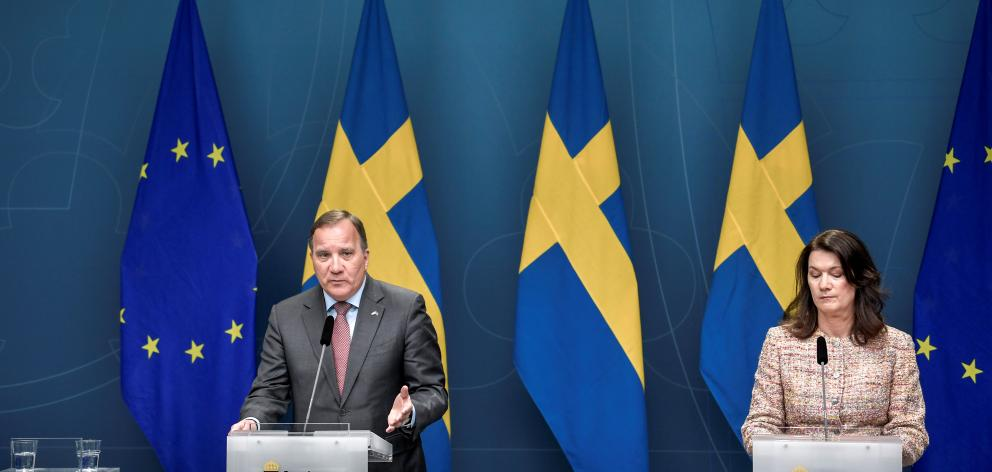Sweden's Prime Minister Stefan Lofven speaks next to Sweden's Foreign Minister Ann Linde during a news conference on the Covid-19 outbreak. Photo: Reuters