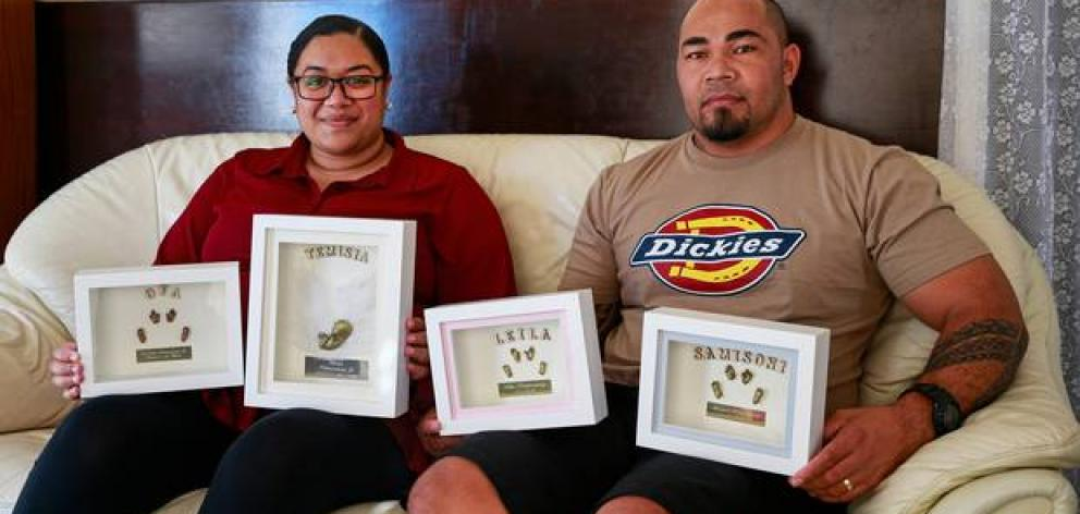 Adi and Ofa Koloamatangi with memories created by Baby Loss NZ for them after their lost their four babies to miscarriage. Photo: NZ Herald