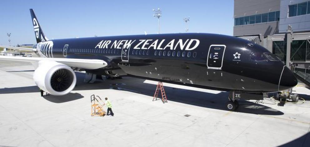 An Air New Zealand 787-9 Dreamliner sits in its stall at the Boeing Delivery Centre in Everett,...