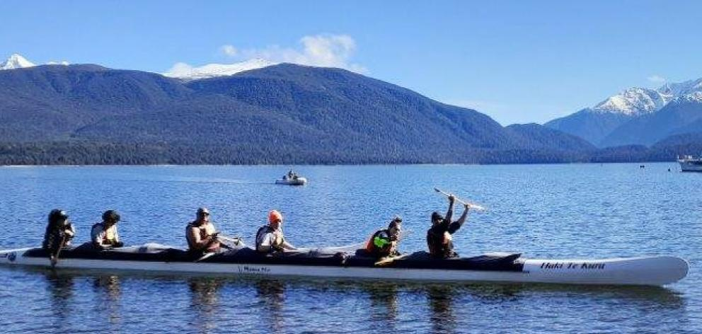 Te Waka Tuhono participants get involved in waka ama to work on being a member of a team. PHOTO:...