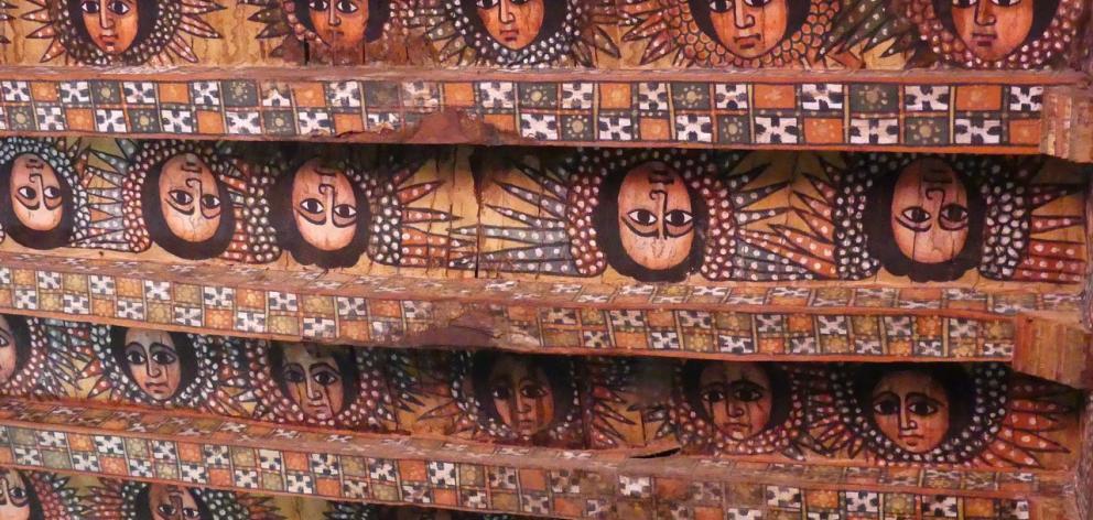 African angels decorate the ceiling and rafters of Debre Berhan Selassie.