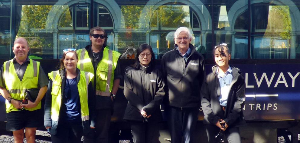 Standing in support of a six-week trial of a commuter train from Mosgiel to Dunedin are Rail &...
