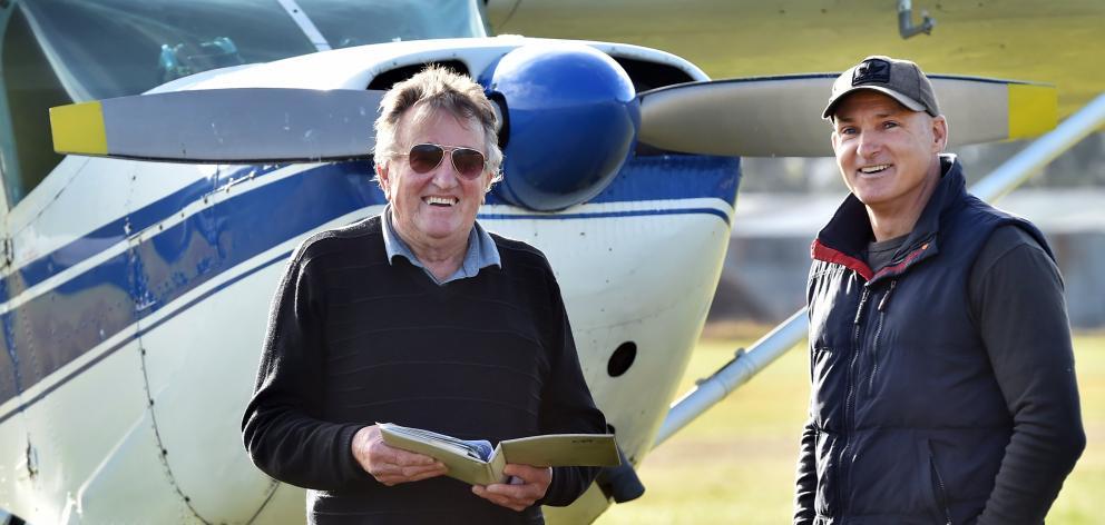 Otago Aero Club chief flying instructor John Penno (left) renews Air New Zealand pilot Jonny...