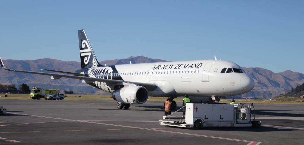 NZ1209 settles on the tarmac from Auckland. Photos: Hugh Collins