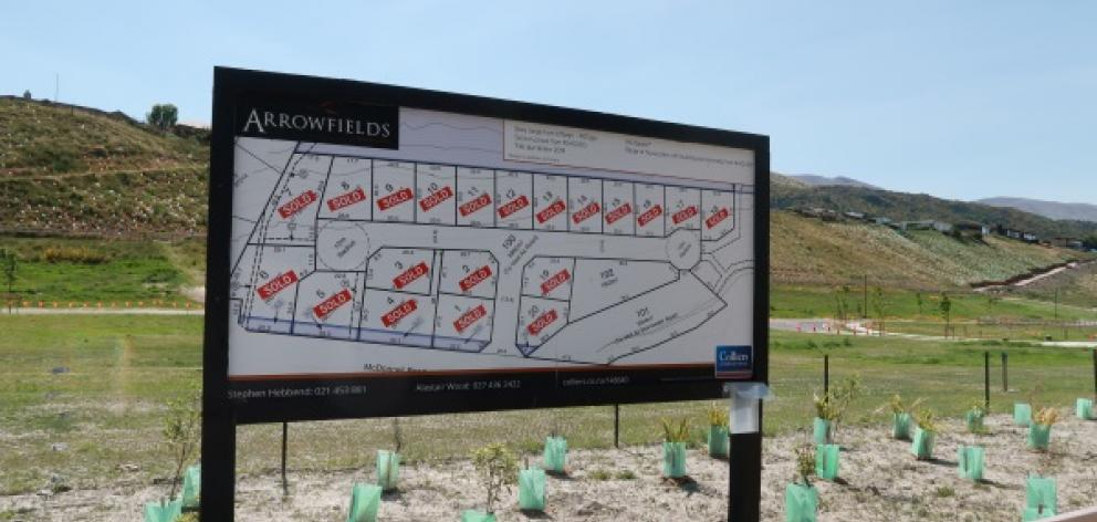 'Sold' signs populate this billboard at Arrowfields. Photo: Mountain Scene