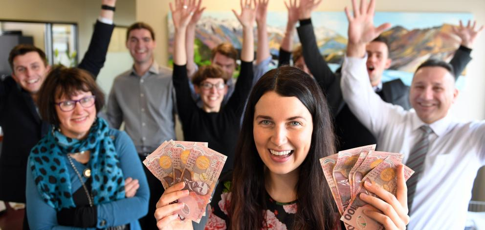 Show me the money ... Jenny Beck Law solicitor Ashleigh Mitchell (right) and her colleagues show...