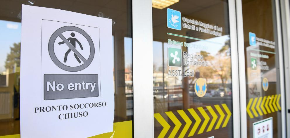 A 'no entry' sign advising that the emergency room is closed is seen on the main entrance of the Codogno hospital amid a coronavirus outbreak in northern Italy. Photo: Reuters