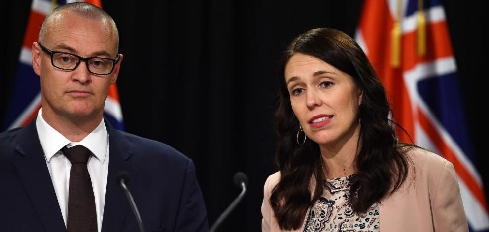 Prime Minster Jacinda Ardern with Health Minister David Clarke. Photo: Getty Images