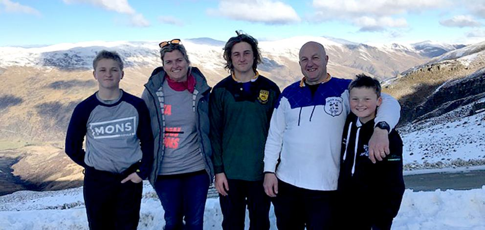 Wayne Jones on the skifield with his wife Joanna and sons Ben, Sam, and Olly. Photo: Supplied