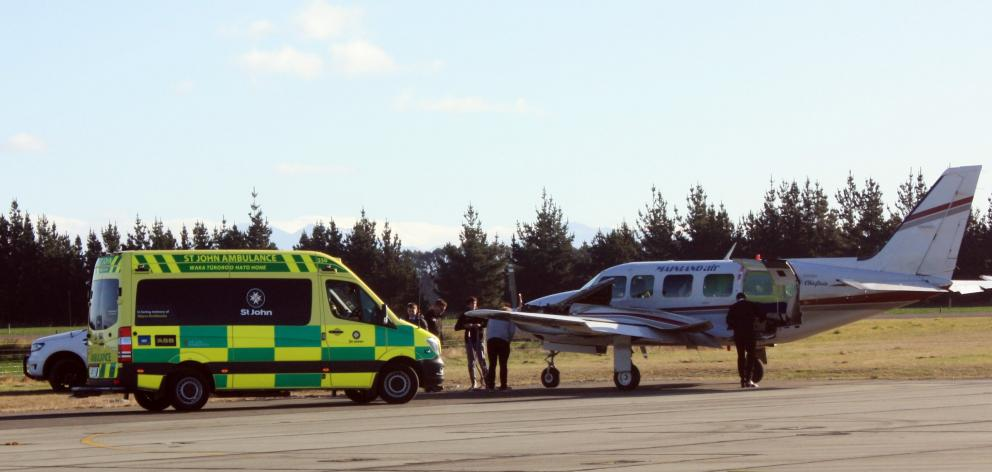 An ambulance was called to take a patient to Dunedin Hospital after the plane they were on was...