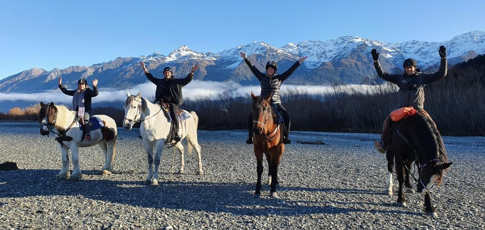 British workers living in Queenstown (from left) Abbie Smith, John Lihou and Keri Paliczka, with...