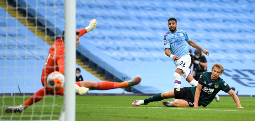 Riyad Mahrez scores for Manchester City in their win over Burnley this morning. Photo: Getty Images