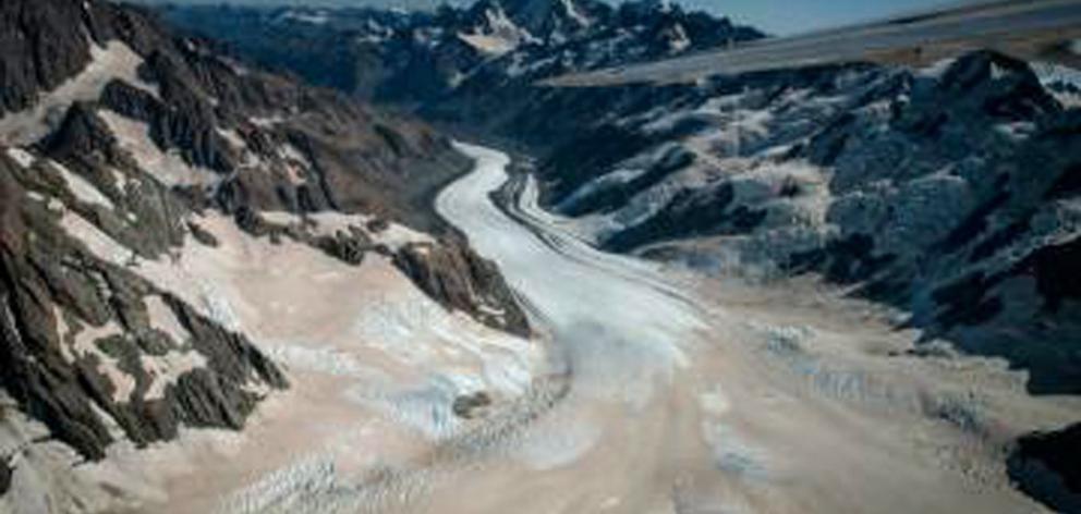 Brewster Glacier, in Mt Aspiring Park, covered in ash from the 2019-20 Australian bushfires....