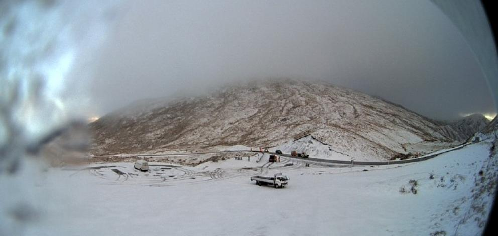 A webcam image showing snow on the Crown Range Rd this morning. Photo: MetService