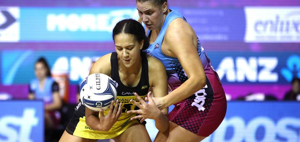 Pulse shooter Aliyah Dunn and Steel defender Te Huinga Reo Selby-Rickit battle for the ball...
