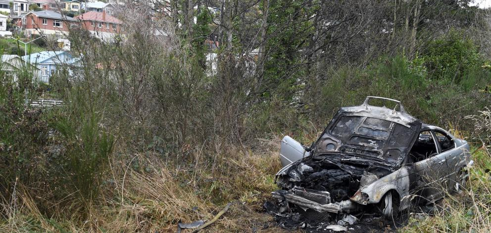 A car was found well ablaze in bush near Caversham Valley Rd yesterday. PHOTO: STEPHEN JAQUIERY