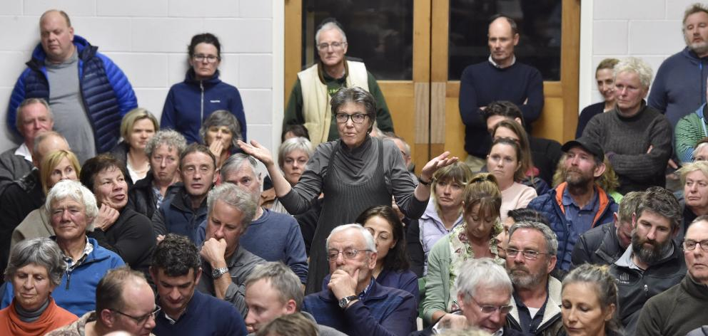 Barbara Armstrong, of Cromwell, makes a point during a meeting in Tarras last night over the...