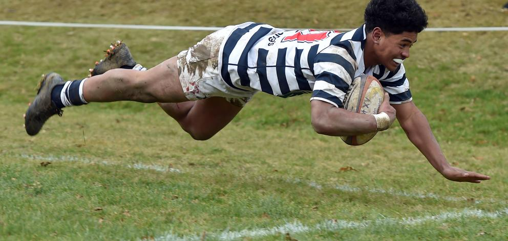 Otago Boys High School winger Hopoate Finau goes over to score a try during the Otago Boys High...