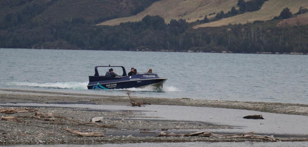 A jet-boat from Dart River Adventures carries police officers as they look for the body of Martin...
