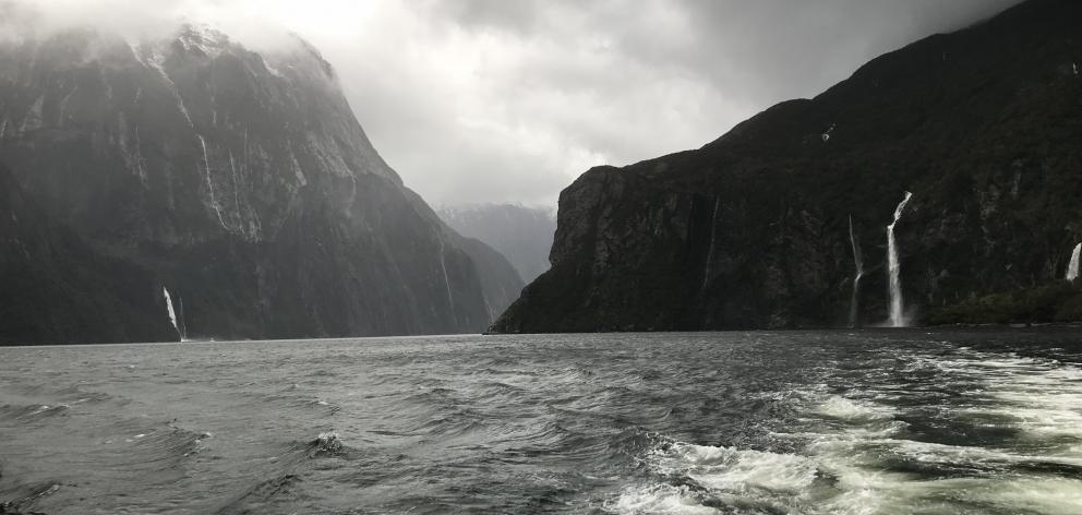 Waterfalls come to life during a storm in Milford Sound.
