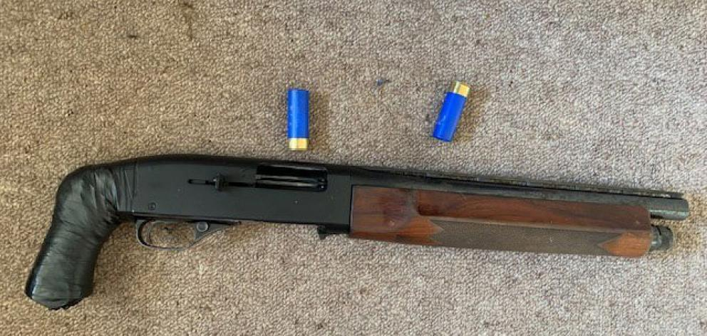 Police found a loaded sawn-off semi-automatic shotgun beside Marriner's bed. PHOTO: NZ POLICE