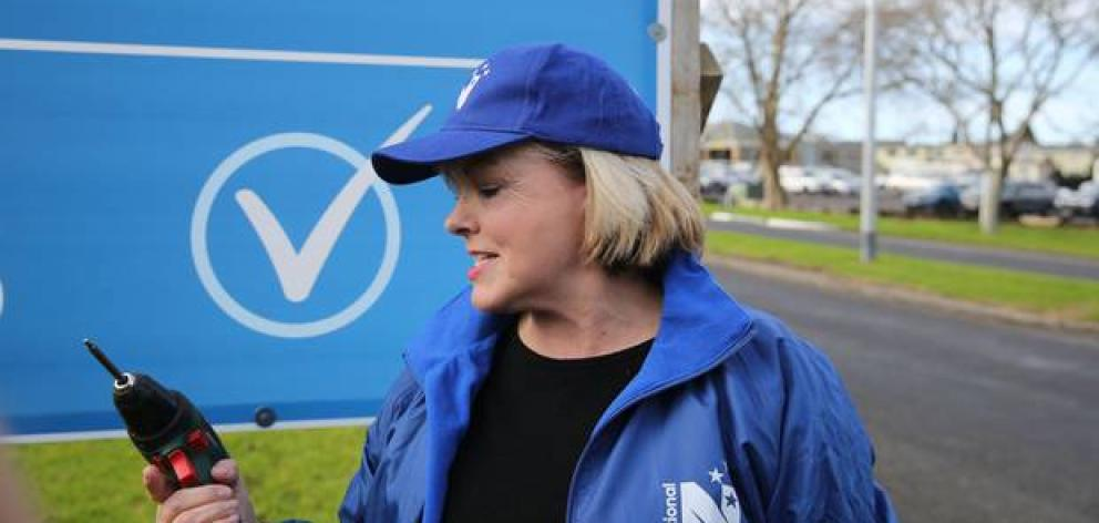 Judith Collins after helping put up a new election billboard today. Photo: Sylvie Whinray via NZ...