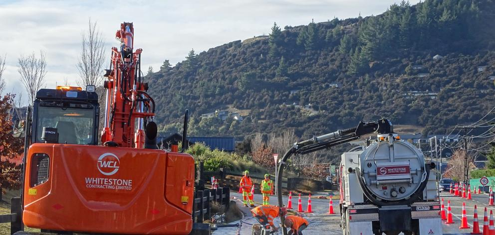 Contractors pump out the last of the floodwaters on Aubrey Rd, Wanaka. PHOTOS: KERRIE WATERWORTH