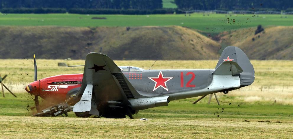 A World War 2 Yak 3 fighter plane slides to a halt after hitting  a cherry picker on the grass...