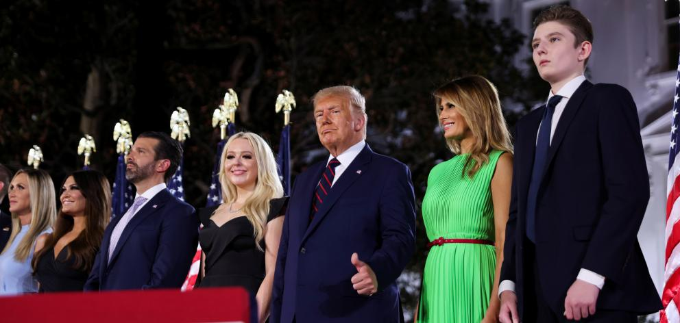 U.S. President Donald Trump gives a thumbs-ups next to first lady Melania Trump and their extended family after accepting the Republican presidential nomination during the final event of the Republican National Convention. Photo: Reuters